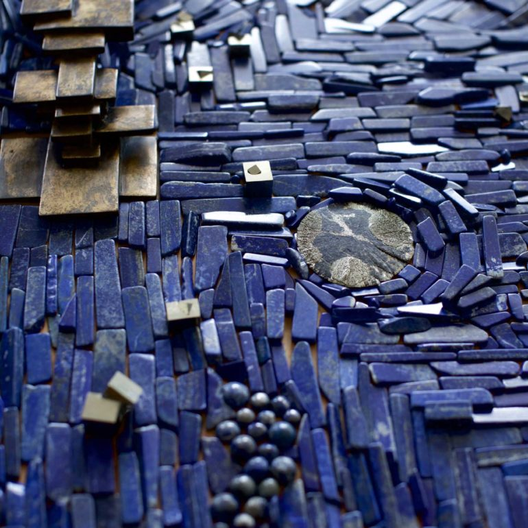 Hand-laid lapis lazuli tile and pyrite appliqués