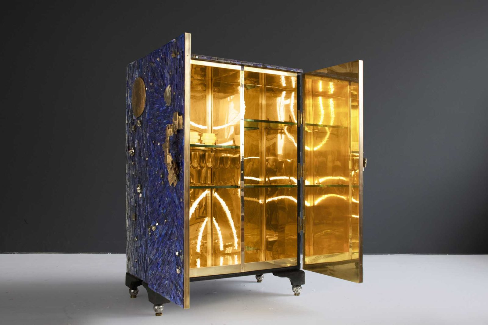 'Curiosity Cabinet' interior is solid brass with quartz crystal lighting